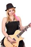 Muchacha con la guitarra eléctrica Foto de archivo libre de regalías