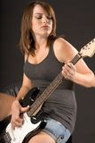 Muchacha con la guitarra eléctrica Imágenes de archivo libres de regalías