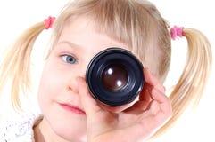 Muchacha con la lente Imagen de archivo libre de regalías
