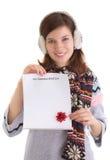 Muchacha con la lista de objetivos de la Navidad Imagenes de archivo