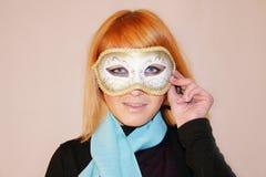 Muchacha con la máscara Foto de archivo