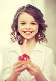 Muchacha con la magdalena Foto de archivo