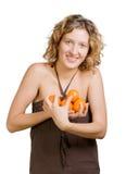 Muchacha con la mandarina fotos de archivo