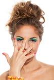 Muchacha con la manicura y el maquillaje coloridos Fotografía de archivo libre de regalías