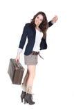 Muchacha con la mano que agita de la maleta del vntage Fotos de archivo libres de regalías