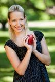 Muchacha con la manzana Imágenes de archivo libres de regalías