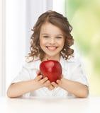 Muchacha con la manzana roja Imágenes de archivo libres de regalías