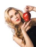 Muchacha con la manzana roja Fotos de archivo libres de regalías