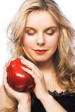 Muchacha con la manzana roja Imagenes de archivo