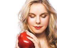 Muchacha con la manzana roja Fotos de archivo