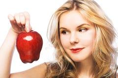 Muchacha con la manzana roja Fotografía de archivo libre de regalías