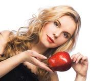 Muchacha con la manzana roja Imagen de archivo