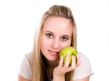 Muchacha con la manzana verde a disposición Foto de archivo libre de regalías