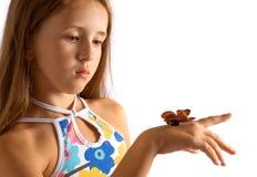 Muchacha con la mariposa artificial Imagen de archivo libre de regalías