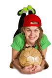Muchacha con la mentira de la bola propensa Foto de archivo libre de regalías