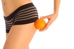 Muchacha con la naranja Imagen de archivo libre de regalías