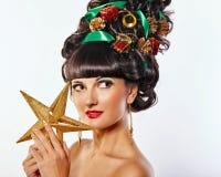 Muchacha con la Navidad creativa del estilo de pelo Imagen de archivo libre de regalías