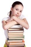 Muchacha con la pila de libros Imagen de archivo