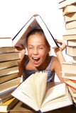 Muchacha con la pila de libros fotos de archivo libres de regalías