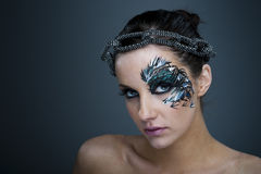 Muchacha con la pintura artística hermosa de la cara Imagen de archivo libre de regalías
