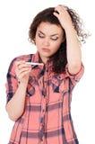 Muchacha con la prueba de embarazo Foto de archivo libre de regalías