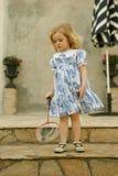 Muchacha con la raqueta Fotografía de archivo libre de regalías