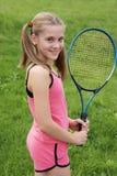 Muchacha con la raqueta de tenis Fotografía de archivo