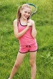 Muchacha con la raqueta de tenis Fotos de archivo libres de regalías