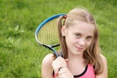 Muchacha con la raqueta de tenis Imágenes de archivo libres de regalías