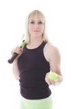 Muchacha con la raqueta y la bola de tenis Fotografía de archivo