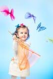 Muchacha con la red de la mariposa Imagen de archivo