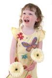 Muchacha con la risa de las flores fotos de archivo