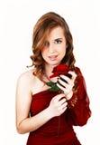 Muchacha con la rosa del rojo. Imagen de archivo libre de regalías