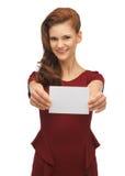 Muchacha con la tarjeta de nota Foto de archivo libre de regalías