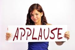 Muchacha con la tarjeta del aplauso Fotografía de archivo