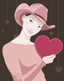 Muchacha con la tarjeta en forma de corazón a disposición Imagen de archivo libre de regalías