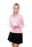 Muchacha con la taza de té/de café Fotografía de archivo libre de regalías