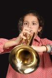 Muchacha con la trompeta Fotos de archivo