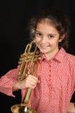 Muchacha con la trompeta Foto de archivo libre de regalías