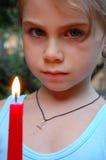 Muchacha con la vela Imagen de archivo libre de regalías