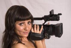 Muchacha con la videocámara Fotografía de archivo