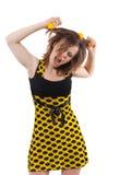 Muchacha con las bolas amarillas en el pelo aislado en blanco Foto de archivo