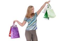 Muchacha con las bolsas de papel Foto de archivo