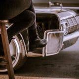 Muchacha con las botas negras Fotos de archivo libres de regalías