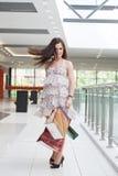 Muchacha con las compras Foto de archivo