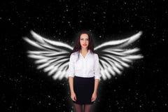 Muchacha con las estrellas de las alas del ángel Fotografía de archivo