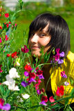 Muchacha con las flores Imagen de archivo libre de regalías