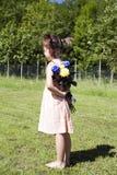 Muchacha con las flores Fotos de archivo libres de regalías
