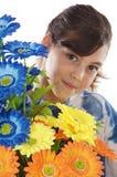Muchacha con las flores Fotos de archivo