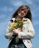 Muchacha con las flores Imagen de archivo